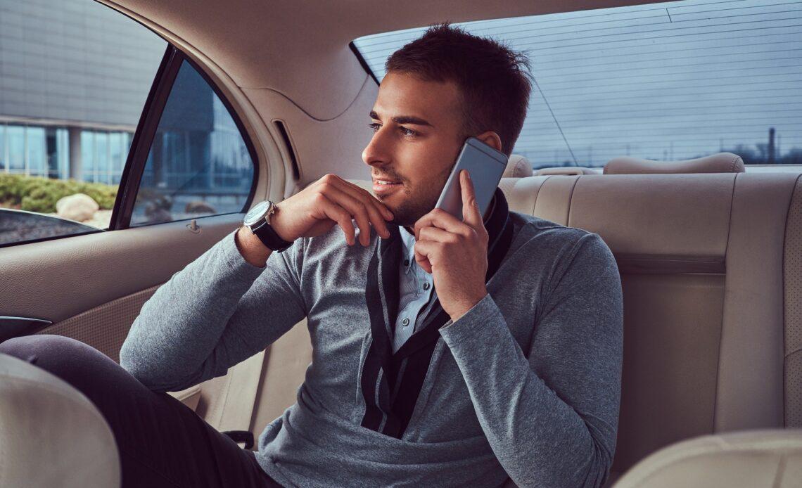 A handsome businessman in luxury car